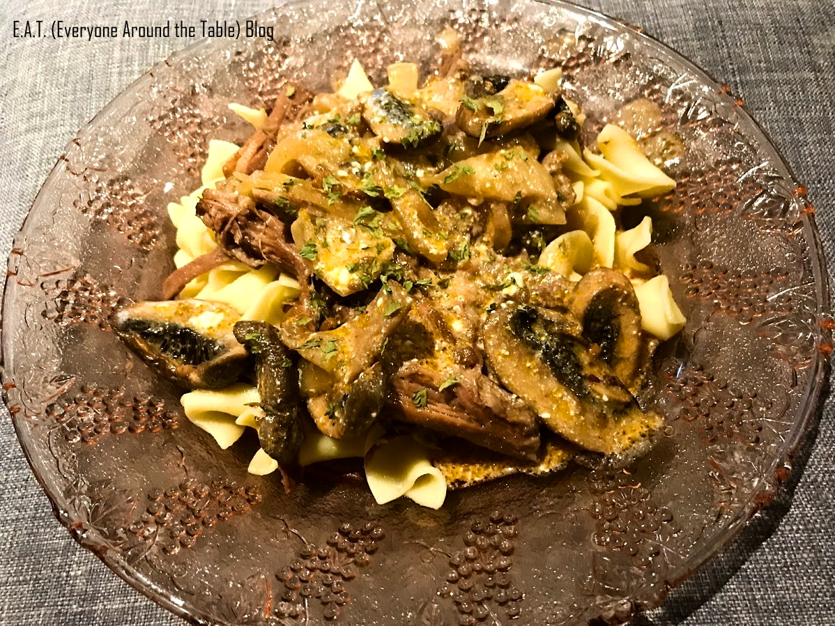 EAT - Beef and Noodles with mushroom onion sauce Served angle