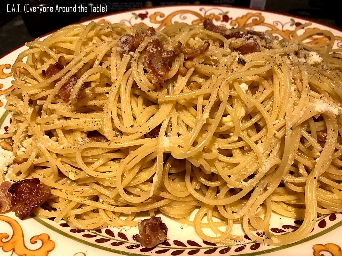 The raw egg cooks in the heat of the noodles and adheres to the Pasta Carbonara.