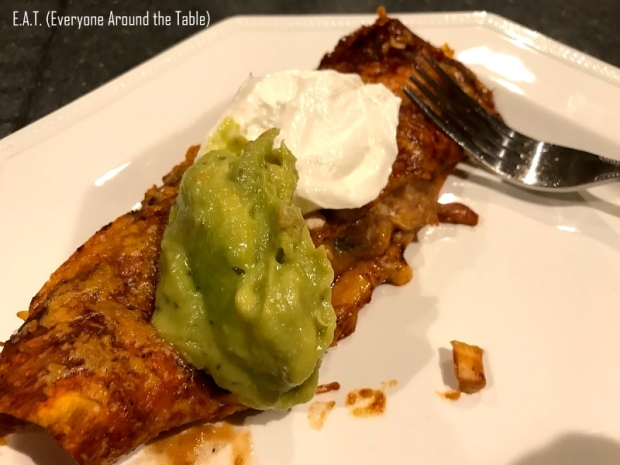 Serve Chicken Enchiritos with guac and sour cream.